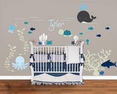 sticker mural chambre bébé sur le thème marin avec un lit bébé