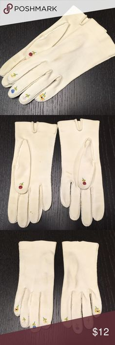 Vintage Gloves with Floral Embroidery Sweet white gloves with embroidered flowers on the finger tips. Size small. Gloves have some aging color to them (see second picture) but a quick bath might do the trick on them. Please ask all questions before purchasing, sold as is. Vintage Accessories Gloves & Mittens