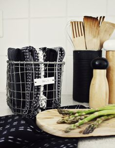 Like the wire basket, but love the painted can holding the utensils.