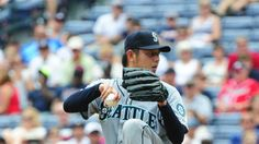 ATLANTA, GA - JUNE 4: Hisashi Iwakuma #18 of the Seattle Mariners throws a 2nd inning pitch against the Atlanta Braves at Turner Field on June 4, 2014 in Atlanta, Georgia. (Photo by Scott Cunningham/Getty Images) ▼4Jun2014GettyImagesViaYahoo!News|Seattle Mariners v Atlanta Braves http://news.yahoo.com/photos/seattle-mariners-v-atlanta-braves-20140604-173331-442--mlb.html