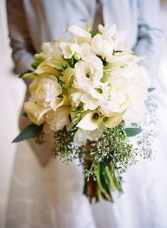 White bridal bouquet with Ranunculus, Calla Lily, Fressia.  Photo by Jamie Clayton.