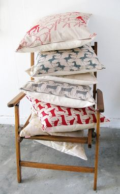 pretty fabrics handsewn over cushions - if you're feeling really creative, use plain fabric and tye dye, silk screen, or stamp before sewing into a pillow.