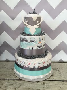 Aztec Diaper Cake in Mint and Grey, Tribal Baby Shower Centerpiece by AllDiaperCakes on Etsy https://www.etsy.com/listing/264525840/aztec-diaper-cake-in-mint-and-grey