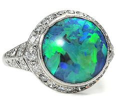 """Black Opal & Diamond Ring, J.E. Caldwell & Co.: ca. 1925, American, three carat """"black"""" opal in platinum set with thirty-eight single cut and two old European cut diamonds. """"Jewelry from the Art Deco era was regarded as """"uber-modern"""" and platinum was the ultimate metal of choice for elegance and sophistication of the age."""""""