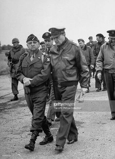 Lt. Gen in Korea Walton H. Walker walking with Douglas MacArthur.