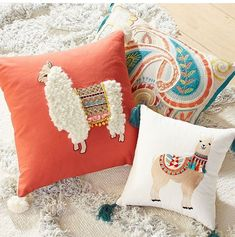 Yeah I know at least one of the pillows is a llama but the other looks like an Alpaca and alpacas are of the llama family anyway. Alpacas, Llama Pillow, Llama Llama, Peru Llama, Llama Face, Baby Llama, Funky Cushions, Decorative Cushions, Outdoor Cushions