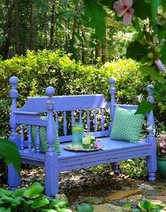 A garden bench made from an old headboard and footboard of a bed.  How cool is that?