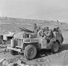 Two members of 1st SAS , Captain D C Mather MC, Welsh Guards and Captain G Alston, Royal Artillery (nearest camera) in a heavily loaded jeep.