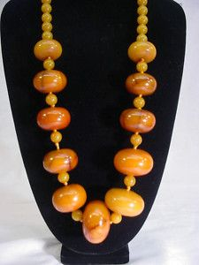 "African amber beads : Russ Nobbs says ""Many of these uniform shaped ""African Amber"" beads are Phenolic plastic beads from the early 20th century."""