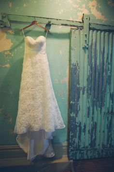 The rustic wedding dress is great and all, but I LOVE the sliding door and peeling green paint.
