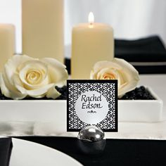 Silver Round Card Holders with black cards for the wedding guests table seating.