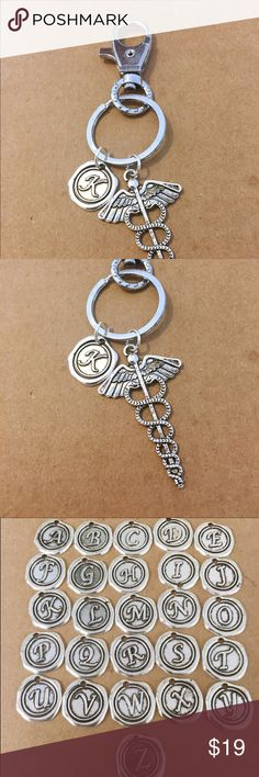 Medical caduceus charm key chain Large key chain. Great gift for a doctor, pharmacist, dentist, nurse and the list goes on. Let me know your initial. Key chain measures 70mm Jewelry