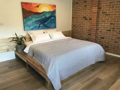 Whale Tree Studio has an industrial-chic style feel and is furnished with a number of our re-purposed creations, including a king size pallet bed with sumptuous bedding. The beautiful oversized, rustic style bathroom subtly brings the outdoors in and the private deck with serene farmland and Tarkeeth Forest views allows for hours of relaxation. A BBQ and seating are also provided. During the day you can enjoy watching the native birdlife and wildlife. Industrial Chic Style, Rustic Style, Adult Loft Bed, Antique Beds, Bed Plans, Bed Mattress, Bathroom Styling, How To Make Bed, Bed Frame