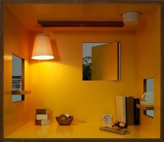 The koloro-desk has windows at various locations, opening to give a more open, accessible feel and when closed creating a small private room where no one can disturb you. Lighting and potted plants can be added, and there are windows for displaying the occasional ornament, hooks for bags, and a cord manager allowing PC use.