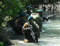 """On patrol on the river for Italian Lagunari soldiers.  The """"Serenissima"""" Regiment is an elite amphibious unit of the Italian Army."""