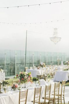Rooftop table at The London WeHo. Photography by onelove-photo.com Design + Coordination by mybridestory.com/index2.php Floral Design by fleuretica.com  Read more - http://www.stylemepretty.com/2013/07/31/west-hollywood-wedding-from-onelove-photography/