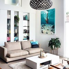 The colors in this room are reminiscent of the sea, and the David Trubridge KINA pednant light (whose shape and name are based on a sea urchin) makes it even more so. Click image for where to buy or to sign up for our newsletter.