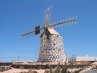The windmills of FuerteVentura in Canary Islands are found throughout the island and remind us of the past and strong agricultural tradition Fuerteventura Island, Canary Islands, Attraction, Skyscraper, The Past, Building, Wind Mills, Canario, Dali