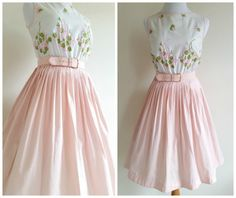 Vicky Vaughn has done it again! Another perfect full skirted tea length dress from the 1950s - 1960s from one of my favorite vintage designers. White and pink cotton sundress with matching pink belt! Looks as if its never been worn. Green and pink embroidered flower bouquets and bunches sprinkle the bloused bodice. Smocked waist gathers the top and pleated skirt to form the perfect hourglass shape. Truly Stunning!