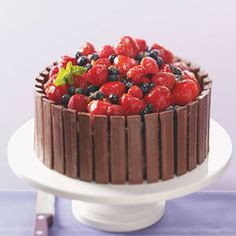 Kit Kat wrapped chocolate cake with fresh fruit topping