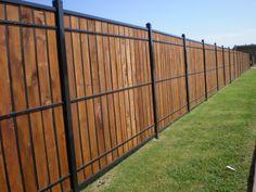 Viking Fence - Austin, TX, United States. oz-post wood and wrought iron
