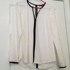 White and Black Top NWOT white top with black detailing. Long sleeves. Optional front neckline closure hook. Very high quality and absolutely stunning! Dalia Tops Blouses