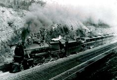 Horseshoe Curve Power - Pennsylvania Railroad Photographs. PRR's ubiquitous K4s's were assigned to almost any role, including helper service, as can be seen here. Helpers were always positioned at the front of passenger trains, so as not to disturb the clientele.