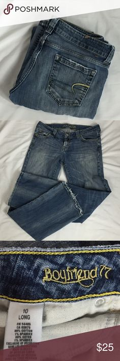 American Eagle Boyfriend 77 Jeans Size 10 Distressed edges Yellow and blue embroidery on back pockets Bootcut Missing back name label Back bottom hems have wear as pictured. See pictures for materials and measurements. B4 American Eagle Outfitters Jeans Boot Cut