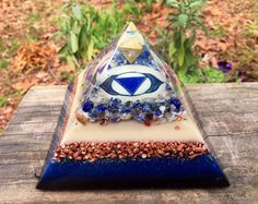 Balance, activate and expand the third eye, or Ajna or third eye chakra with this powerful Ascension pyramid. This energy center is governs the mental body, intuition, dreaming, meditation, multi-dimensional awareness and expansion. The is the seat of the eternal and infinite aspect of self. An orgone tetrahedron is the focal point here, it is pointed downward to symbolize the connection of the divine self being refined down to a single point of manifested awareness. The orgone tetrahedron…