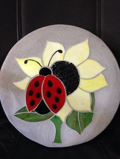 Cute little ladybug stained glass mosaic garden stepping stone is 10.5 round and is 1.5 thick. Use her in a garden or walkway. Price includes shipping