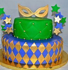 Mardi Gras themed fondant cake with edible mask.