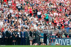 Britain's Prince William, Duke of Cambridge, (centre right) and Football Association chairman Greg Clarke (centre left) observe a minute of silence in memory of those affected by the Manchester bombing ahead of the English FA Cup final football match between Arsenal and Chelsea at Wembley stadium in London on May 27, 2017. / AFP PHOTO / Adrian DENNIS / NOT