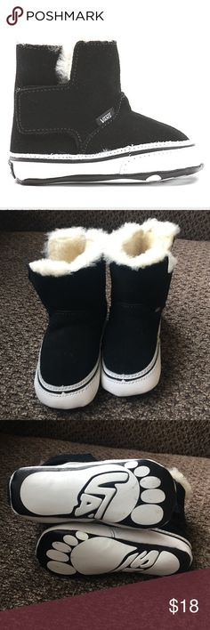 Vans infants slip on boots Furry inside, suede outside. Cushioned support with easy velcro. Box not included. Small removable marks on bottom of shoes. Lightly worn, excellent condition. Vans Shoes Boots