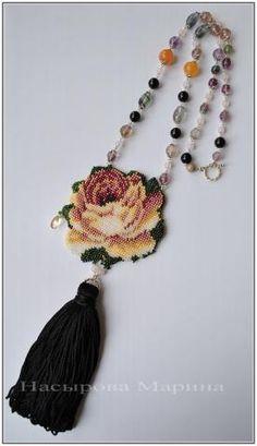needlepoint ? flower and tassel