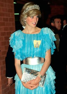 Princess Diana in a pale blue evening dress with a broad silver belt and a matching clutch bag, she also wear The Diamond Spencer Tiara, as she arrives for a dinner hosted by the Province of New Brunswick.