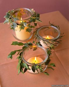 These informal, inexpensive lanterns are ideal for a garden wedding, as the jars protect the flame from breezes. Wrap a piece of flexible greenery around the jar just below the lip, and twist a piece of floral wire around the ends to secure. For a fuller look, encircle the jar two or three times. The jars here are decorated with ivy, willow, and myrtle; other good options are seeded eucalyptus and variegated pittosporum.