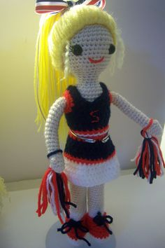 This little girl is wearing a cheerleader outfit just like her 9 year old owner. Doll pattern from Sugar 'n Cream and I came up with the outfit.