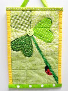 "mini wall quilt- shamrock with ladybug- ""Climbing O' the Green"". $23.00, via Etsy."