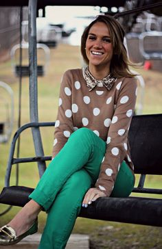 @Donna Maywald Navy polka dot sweater, green pants, metallic loafers
