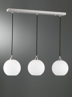 FL2290/3/986 Vetross Ice 3 light on a bar with opal spherical glass, satin nickel & white. 3 Opal Sperical glasses on a bar with black braided cord suspension on a satin nickel metalwork. 3 x 40w E14 Golf Ball Lamps not included Height- 115cm Minimum Height- 30cm Width- 80cm BRAND- Franklite REFERENCE- FL2290/3/986 AVALIABILITY- 3-4 Working Days ** Can be supplied with electronic controle gear & low energy lamps. **Can be supplied with an intergral Frankled solution. Please ring 01793…