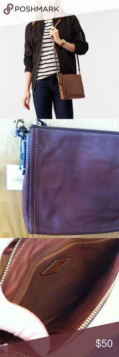 "Fossil Emma EW Crossbody Leather Purse, NWT Silhouette:   Crossbody   Tech Compatibility:   iPad® mini   Exterior Material:   Leather   Interior Details:   1 Slide Pocket and 1 Zipper Pocket   Measurements:   9.75""L x 1.5""W x 8.5""H Fossil Bags Crossbody Bags"