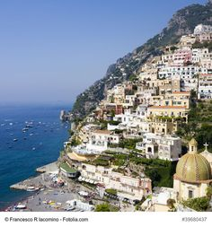 """Panorama of Positano, Amalfi Coast, Italy - Positano is a town built on the face of a cliff and one of the most popular Italian holiday destinations. Known for its colorful houses standing on top of each other and wonderful beach overlooked by the Monti Lattari, this gem is a perfect place to explore the true """"Costiera Amalfitana"""" beauty."""