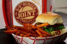 """Try some delicious specialty burgers at S & B's Burger Joint in Oklahoma City. The """"Elvis"""" is one of their most popular flavors and comes topped with bacon, tomato, red onion, lettuce and peanut butter."""