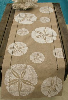 Coastal Clearance Sale. White Sand Dollar on Natural Linen Runner. $49.99