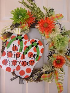 Love the greens and oranges together, not so much a fan of the huge flip flops on it though :)
