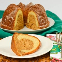 A delicious bundt cake with cinnamon, oats, & pecans crowned with a layer of vanilla.