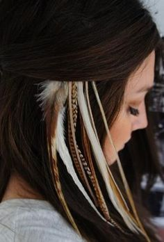 So usually I don't really like feather extensions, but I like how it's natural colors that kind of blend with her hair.