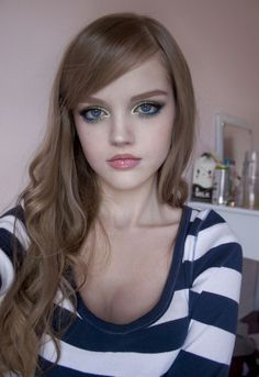 A pretty look. While a little edgy with metallic eyeshadow and blue mascara.