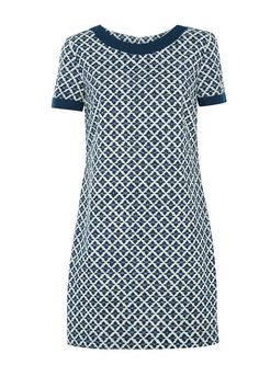Hand printed navy shift dress with tile pattern in 100% cotton. Above knee length with contrast neckline & cuffs and concealed back zip. Length 91cm.