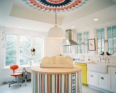 Create a Ceiling Medallion In a neutral-hued room, create a focal point on your ceiling. With bold colors and an eye-catching pattern, you can emphasize a room's height—or merely produce the illusion of height—through such cost-efficient effects as a faux ceiling medallion.